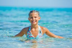 Swimming cute girl Stock Photos
