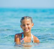 Swimming cute girl Royalty Free Stock Photos