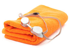 Swimming equipment. Bath towel and swimming glasses isolated on white (shallow DOF Royalty Free Stock Photo
