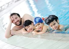 Swimming family. Are very joying Royalty Free Stock Image