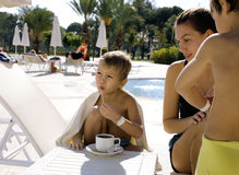 After swimming family near pool. Having hot tea Stock Image