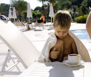 After swimming family near pool. Having hot tea Stock Photos