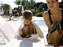 After swimming family near pool. Having hot tea Stock Images