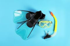 Swimming flippers and mask on color background. Top view royalty free stock images