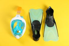 Swimming flippers and mask. On color background, top view stock images