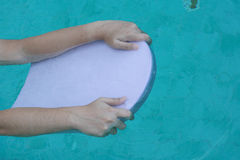 Swimming floating board. In water stock photos