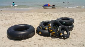Swimming floats made of inner tube tires at the beach. stock photography