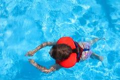 Swimming girl Stock Photos