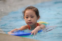Swimming girl Royalty Free Stock Photography