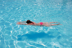 Swimming girl. In the pool royalty free stock photography