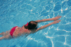 Swimming girl. In the pool stock photos