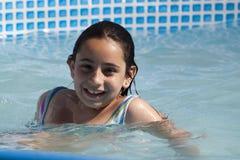 Swimming girl Stock Photography