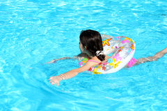 Swimming girl Stock Images