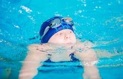 Swimming Girl in the Pool. Teenage Caucasian Girl in the Swimming Pool Royalty Free Stock Photos