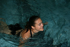 Swimming Girl. Pretty girl swimming in a pool Royalty Free Stock Images