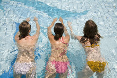 Swimming girls. Swimming teen girls in clear water Royalty Free Stock Photography