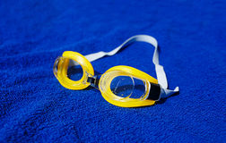 Swimming glasses at the towel Stock Photography
