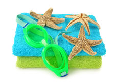 Swimming goggles. On colorful towels royalty free stock photo