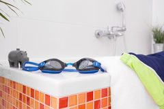 Swimming goggles and bath toy Royalty Free Stock Photos