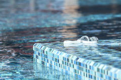 Swimming goggles. Swimming goggle and turqouise swimming pool color Stock Photos
