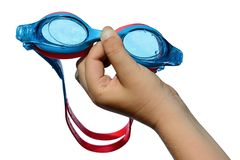 Swimming goggles held in small boy left hand on white background, with drops and traces of salt water on it Royalty Free Stock Images