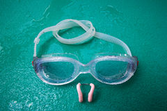 Swimming goggles with nose clip Stock Photos
