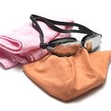 Swimming goggles and towel. Isolated on white background royalty free stock photography