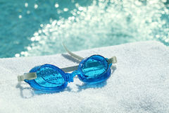 Swimming goggles on towel stock photography