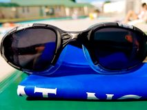 Swimming googles by the pool. Swimming googles by the swimming pool Royalty Free Stock Photography