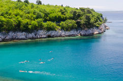 Swimming in green adriatic sea Royalty Free Stock Photography