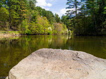 Swimming Hole. An idyllic setting to jump off a rock into the old swimming hole. Mink Brook, Hanover, NH royalty free stock images