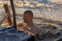 Swimming in the hole for the baptism of the Lord. 19.01.14 Polotsk Belarus. Swimming in the hole in the morning in the cold on the feast of the Baptism of the stock photo