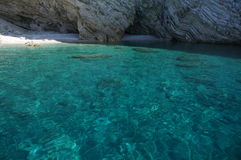 Swimming hole. A beautiful clear swimming hole on the island of Kalomos, Greece stock photo