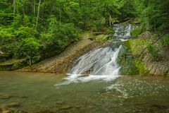 Swimming Hole on Roaring Run Creek. A view of popular swimming hole on Roaring Run Creek in the forest located Eagle Rock, Botetourt County, Virginia, USA stock photography