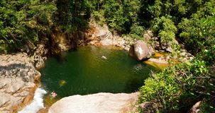 Swimming hole at Wheel of Fire falls in Eungella National Park i. View of swimming hole at Wheel of Fire falls in Eungella National Park in Queensland, Australia royalty free stock images