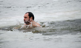 Swimming in the ice-hole. Feast of the Epiphany Royalty Free Stock Photos