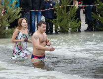 Swimming in the ice-hole. Feast of the Epiphany Stock Photo