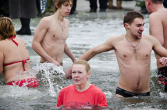 Swimming in the ice-hole. Feast of the Epiphany Stock Photos