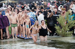 Swimming in the ice-hole. Feast of the Epiphany. The religious feast of the Epiphany. People bathe in the winter in the ice in the river Stock Image