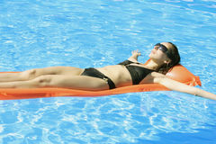 Swimming on an inflatable mattress Royalty Free Stock Photos