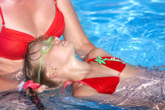 Swimming Instructor learn child swim. Stock Photos