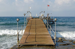 Swimming Jetty, Antalya. A jetty at a hotel in Konakli on the Antalya coastline of Turkey.  The steeply shelving rocky coast means bathers need to head along the Royalty Free Stock Images