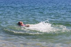 Swimming and Jumping Royalty Free Stock Images