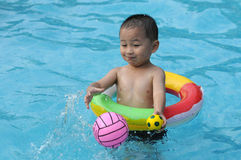 Swimming kid royalty free stock photo