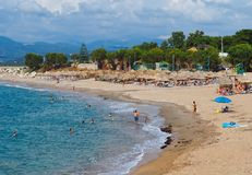 Swimming at Kyparissia Beach, Western Peloponnese, Greece. Holiday makers enjoying a late afternoon summers day at Kyparissia stock photo