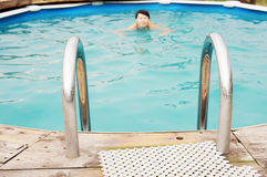 Swimming lady in an outdoor pool Stock Image