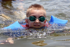 Swimming in the lake. Young boy swimming in the lake Royalty Free Stock Photography