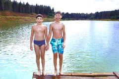 Swimming in the lake on their summer country holiday Royalty Free Stock Photography