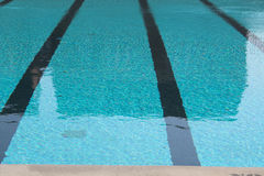 Swimming lanes. Closeup of swimming lanes in a large swimming pool royalty free stock images