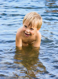 Swimming laughing boy Royalty Free Stock Images